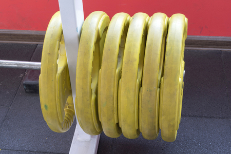 hanged: fitness gym hall equipment. hanged heavy lift weights.