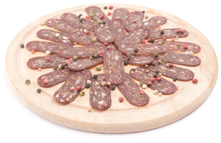 rounder: flat sausage on rounder wooden board isolated Stock Photo