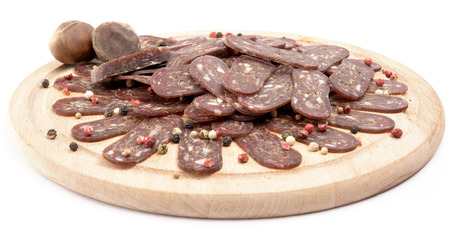 rounder: flat sausage on rounder wooden plank. isolated on white background. Stock Photo