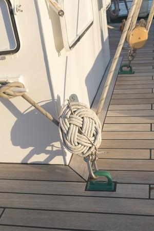 ship deck: sailing ship deck and big sea knot Stock Photo