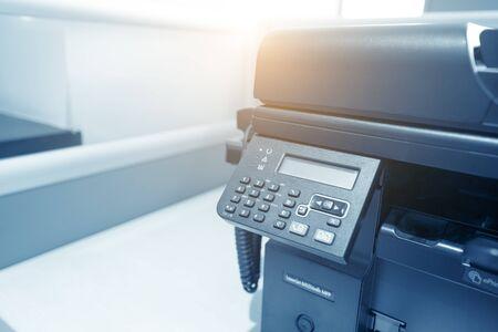 multifunction: Man holding finger on start button of laser printer Editorial