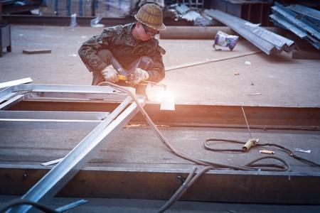 sparking: industrial worker welding sparking Editorial