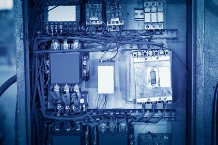 fixer: Telecommunications distribution box close-up, crowded lines. Stock Photo