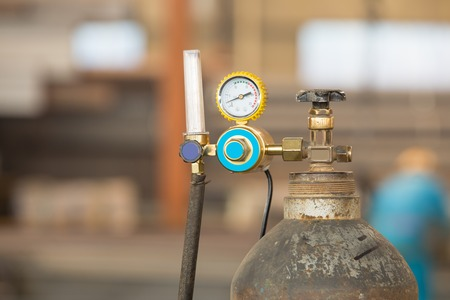 compressed air hose: a welding gas cylinder pressure gauge with two