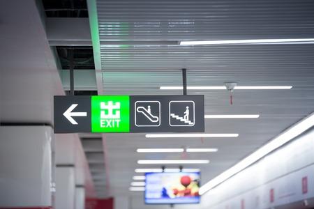 bipedal: Illuminated Corporate Office Exit Sign Closeup. Stock Photo