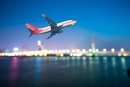 airliner: perspective view of jet airliner in flight with bokeh background