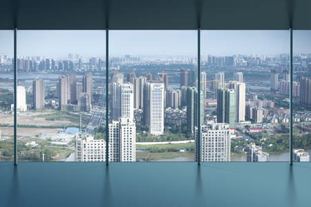 megalopolis: Aerial view of city buildings and river, China Nanchang Stock Photo
