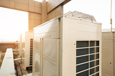 coolant temperature: Air conditioning system assembled on top of a building.