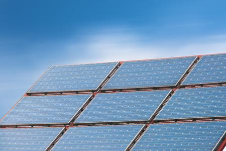 Solar Panels Against The Deep Blue Sky Stock Photo