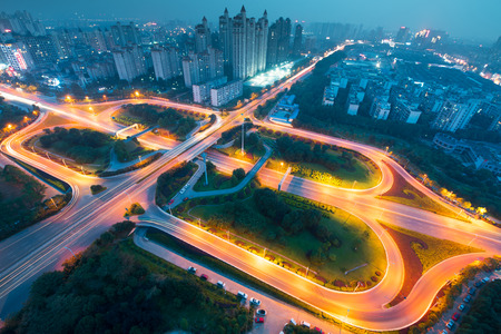Motorway, Expressway, Freeway the infrastructure for transportation in modern city, urban view at night time Editorial