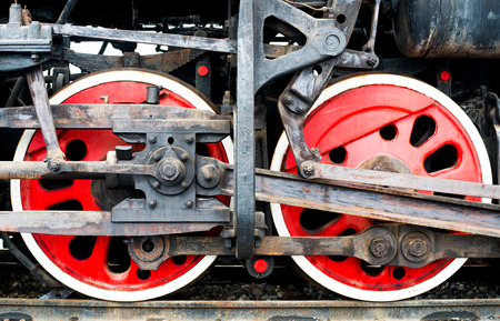 rust red: Detail of the wheels on a steam train Stock Photo