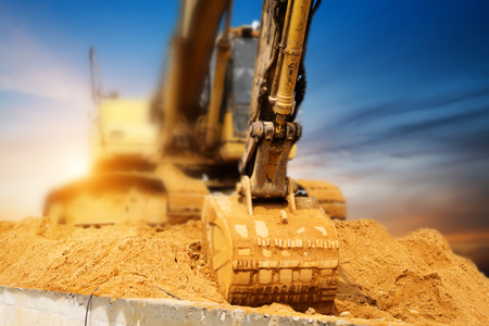 Excavators machine in construction site on sunset background Stok Fotoğraf - 75309216