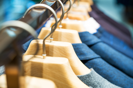 hangers: Clothes hang on a shelf . Cloth Hangers with Shirts. Mens business clothes