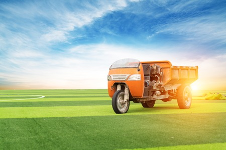 Tractor in a field - agricultural scene in summer Stock Photo