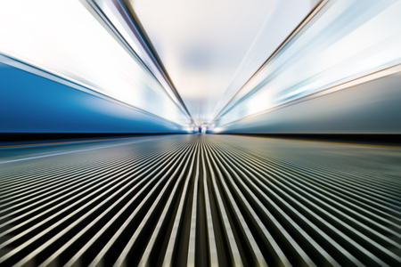 Moving walkway and light on background.