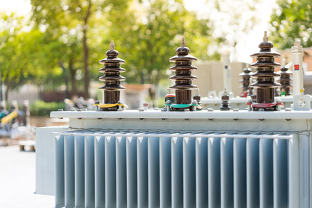 High voltage transformer with electrical insulation and electrical equipment in power substation. Stock Photo