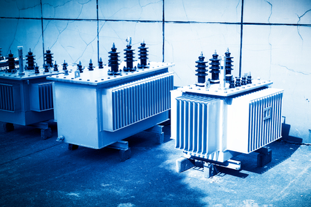 High voltage transformer with electrical insulation and electrical equipment in power substation. Banco de Imagens