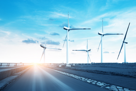 Wind turbines on windy and cloudy day Stock Photo