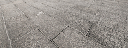 curve road: Perspective View of Monotone Gray Brick Stone on The Ground for Street Road. Sidewalk, Driveway, Pavers, Pavement in Vintage Design Flooring Square Pattern Texture Background Stock Photo