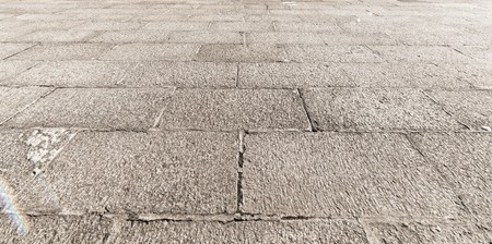 Perspective View of Monotone Gray Brick Stone on The Ground for Street Road. Sidewalk, Driveway, Pavers, Pavement in Vintage Design Flooring Square Pattern Texture Background Stock Photo