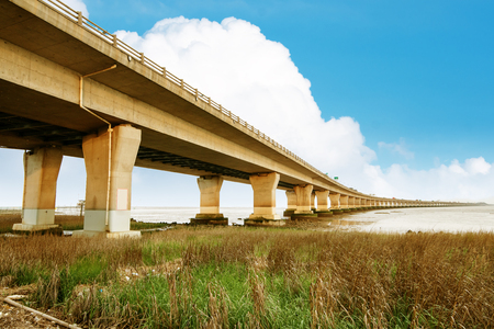 Highway and viaduct under the blue sky Stock Photo