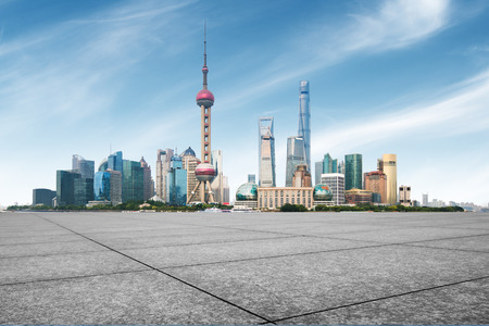 clean asphalt road with city skyline background,shanghai,china.