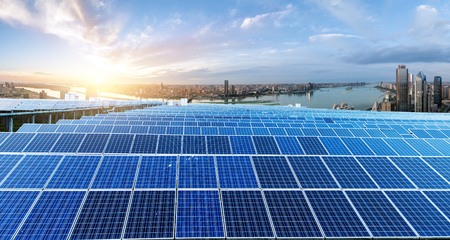 Eco-environmentally friendly green energy of sustainable development of solar power plant with Shanghai skyline