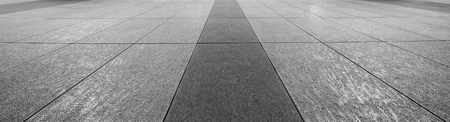 Perspective View of Monotone Gray Brick Stone on The Ground for Street Road. Stock Photo