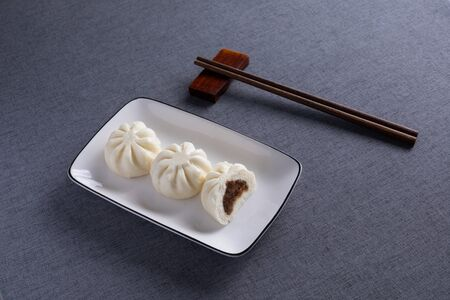 Steamed buns with Red Wood Chopsticks