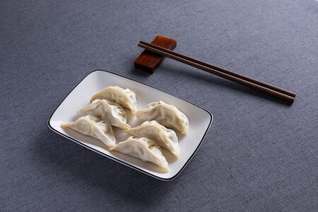 Steamed Dumplings with Red Wood Chopsticks