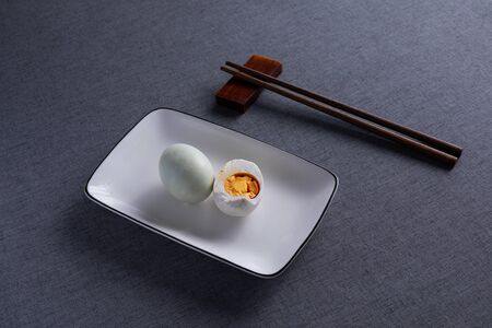 Salted duck eggs placed on a white porcelain plate