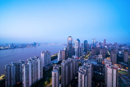 modern high-rise buildings line the new honggutan district in nanchang, jiangxi province.