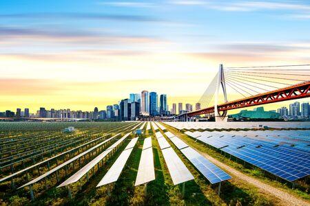 Photo voltaic and modern city skyline, China Chongqing.