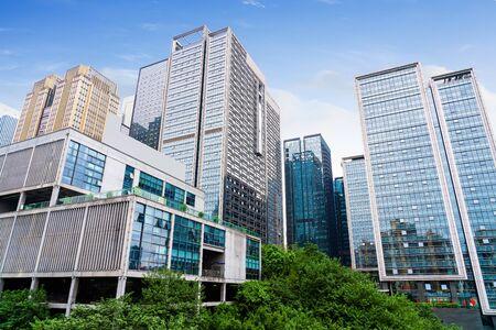 Lawn and dense modern buildings, Chongqing, China.