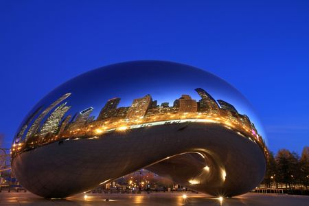 Chicago, Illinois - December 1, 2009:  Lights of the city reflect on Cloud Gate in Millennium Park at dusk