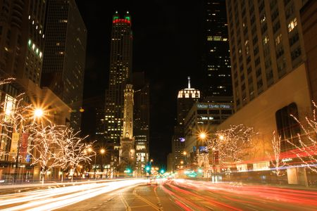 Chicago, Illinois - December 1, 2009:  Holiday lights decorate Michican Avenue's shopping district known as the Magnificent Mile Stock Photo - 6884997