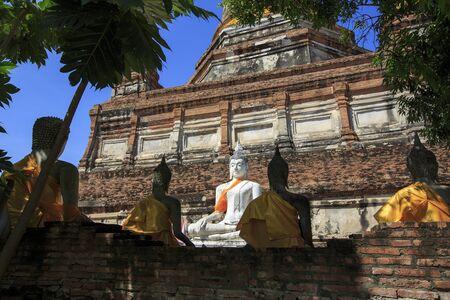 ajutthaya: Buddha statues at the temple of Wat Yai Chai Mongkol in Ayutthaya, Thailand Stock Photo