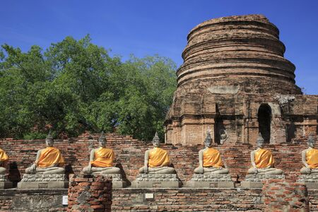 Buddha statues at the temple of Wat Yai Chai Mongkol in Ayutthaya, Thailand Stock Photo