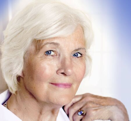 Senior lady portrait on bright background Stock Photo