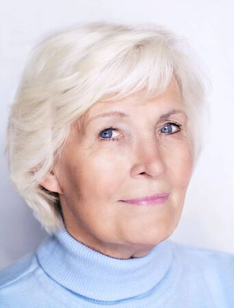 Senior lady with blue pullover Stock Photo