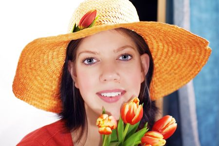 Young woman with strawhat and tulips Stock Photo - 2475577