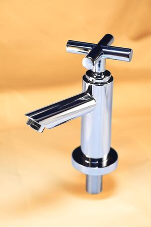 chrom: Water tap on sandcolor background