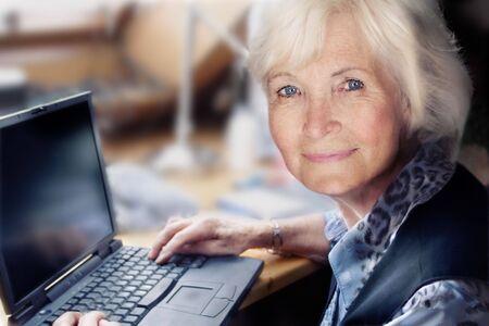 Senior lady ready to start on her laptop Stock Photo - 2475575