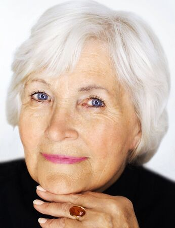 75s: Senior lady with black pullover, Stock Photo