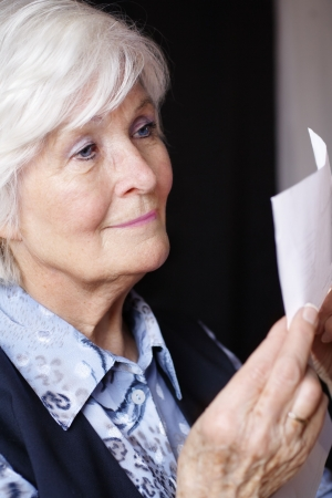 letter head: Senior lady reading a document