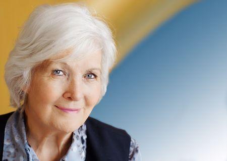 Senior lady on blue yellow background Stock Photo