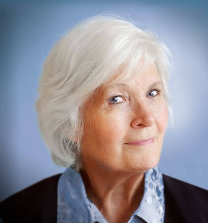 Senior lady portrait, looking humourus Stock Photo