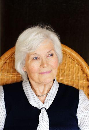 Senior lady on chair