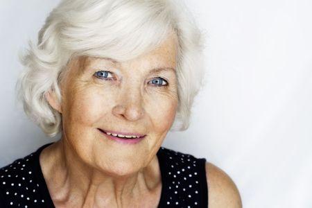gray hairs: Beautiful senior woman summer portrait