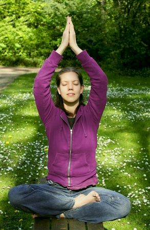 Young woman doing yoga in the park Stock Photo - 3009508